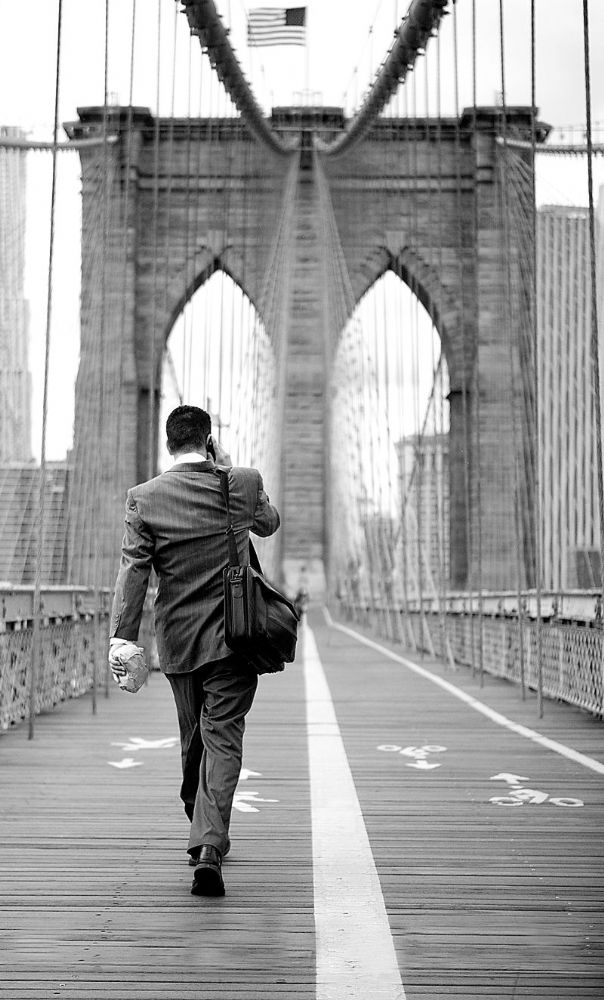 New York City.  Business Man on Brooklyn Bridge